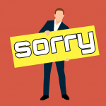 Man holding a sorry sign | Recruitment Agencies Kent